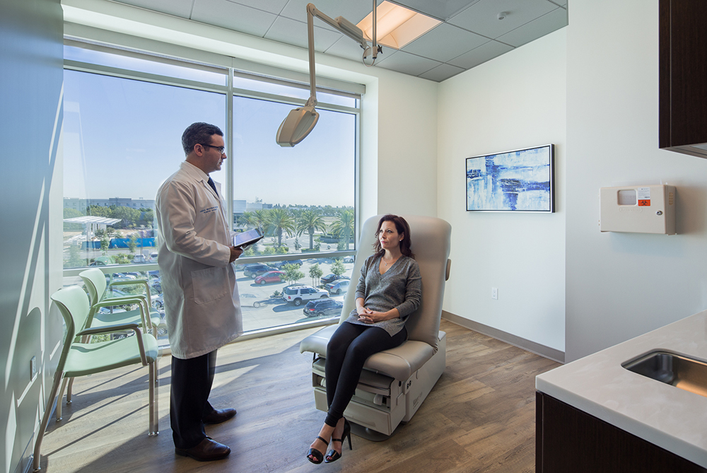 Long Beach plastic surgeon, Dr. Waltzman, consults with a patients in his office